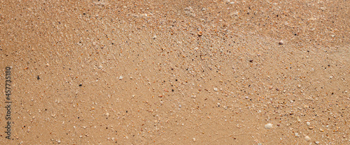 Obraz na plátně Summer day beach sand texture. Top view, flat lay. Banner