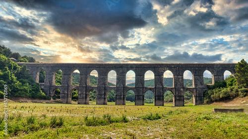 Foto Maglova Aqueduct built by Master Ottoman Architect Mimar Sinan, Beautiful sunset