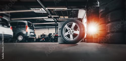 Obraz na plátně tire at repairing service garage background