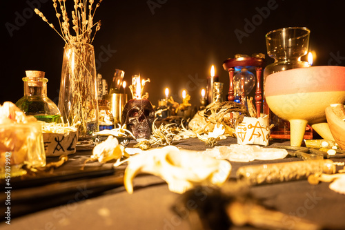 Fototapeta Witchcraft still life with burning candles selective focus on skull