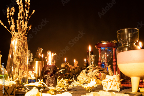 Fotografie, Obraz Witchcraft still life with burning candles selective focus on skull
