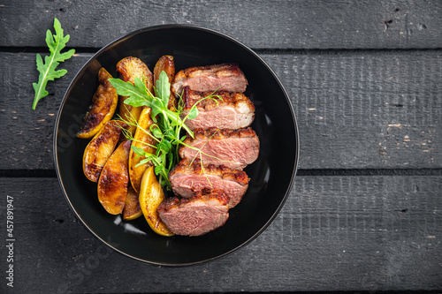 duck breast meat and garnish poultrysecond course side dish fresh ready to eat meal snack on the table copy space food background