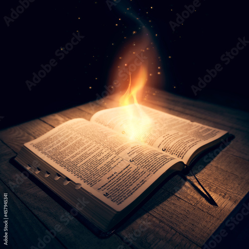Flame coming out of the Holy Bible. Fototapet