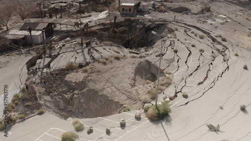 Obraz na plátně Large sinkhole close to house In the desert, Aerial view drone view from dead se