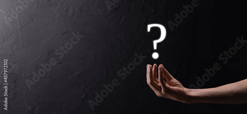 Valokuva Businessman man hand hold interface question marks sign web
