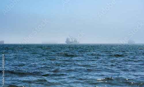 Fotografie, Obraz Seascape with fishing vessel on the roadstead.