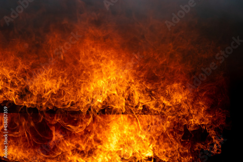 Burning red hot sparks rise from large fire,Perfect fire particles embers on background,Fire flames Fototapet