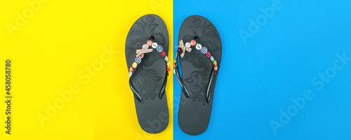 Valokuva flip-flops on a blue-yellow background