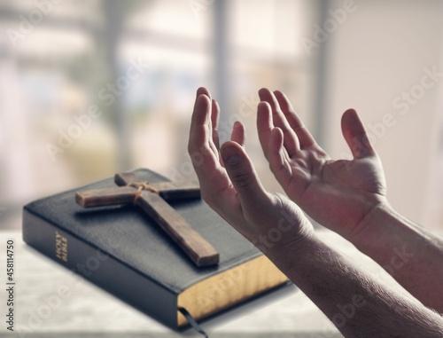 Fototapeta Concept of worship at home. Hand praying and bible study.