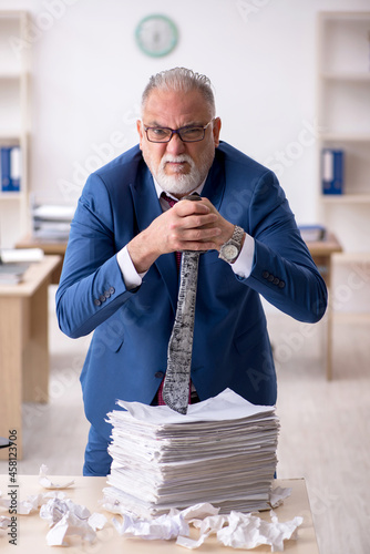 Canvas Old male employee unhappy with excessive work in the office