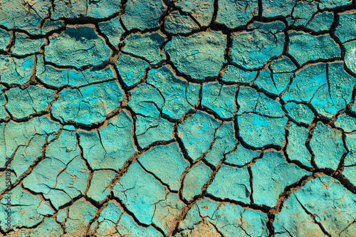 Fotografiet Blue chemical liquid dried over dry cracked land