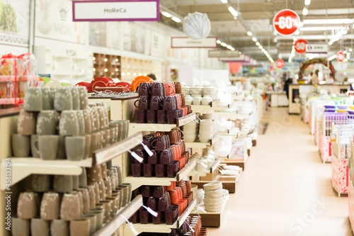 Fotografering supermarket interior with collection of ceramic and tableware