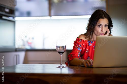 Fotografija Pretty, mid-aged woman having a virtual Wine Tasting Dinner Event Online Using L