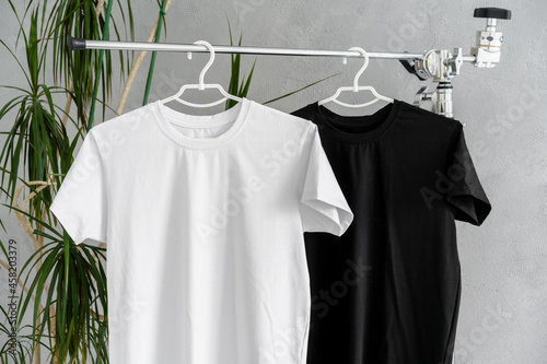 White and black T-shirts on hangers for design presentation