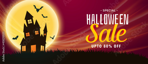 Valokuva spooky halloween sale banner with haunted house and flying bats