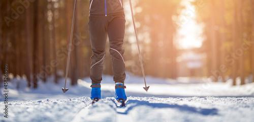Cross country skiing Banner, winter sport on snowy track, sunset background Fototapet