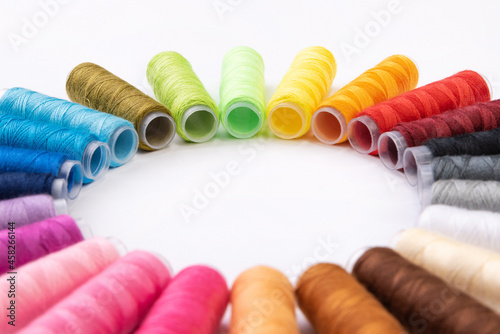 Fotografia, Obraz Close-up of colored sewing threads arranged in a circle