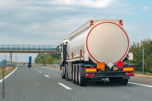 Fotografie, Obraz Tank truck on the road transporting gasoline from refinery to gas station