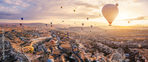 Leinwand Poster Hot air balloons flying above Göreme, Cappadocia (Kapadokya) Anatolia, Turkey at sunrise