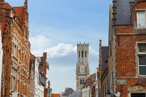 Fotografia Bruges historic gable along the Steenstraat and the famous belfry bell tower as