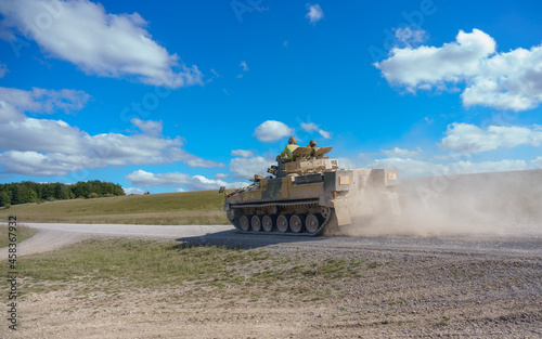 Fotografie, Obraz British army Warrior FV512 army infantry fighting vehicle in action on a militar