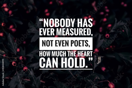 """Valokuva Inspirational love quote with natural background, """"Nobody has ever measured, not even poets, how much the heart can hold"""