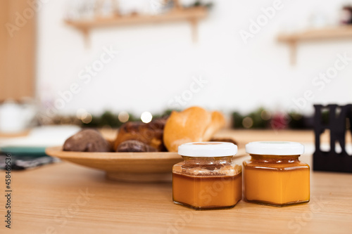 Kitchen table with cookies on plate and honey jars Fototapet