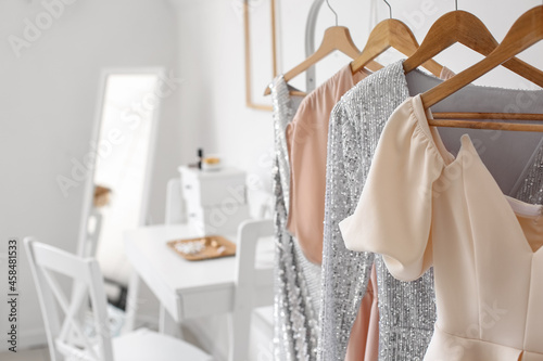 Fototapeta Rack with stylish clothes in room, closeup