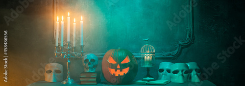 Obraz na plátně Scary laughing pumpkin and old skull on ancient gothic fireplace