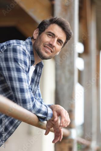 Obraz na plátně portrait of handsome smiling farmer