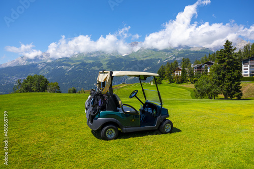 Wallpaper Mural Crans Sur Sierre Golf Course with a Golf Cart with Mountain View in Crans Montan