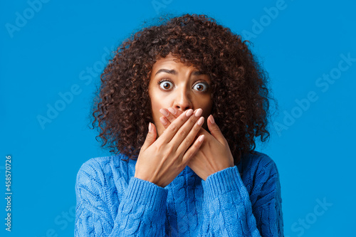 Close-up portrait shocked and scared african-american girl home alone heart stra Fotobehang