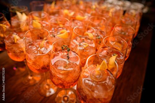 Billede på lærred selective focus on glasses of aperol spritz cocktail with ice cubes and orange s