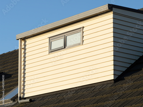 Photo Shed dormer with weatherboard cladding on tile roof
