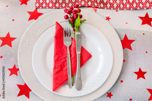 Plates, fork and knife prepared for christmas meal