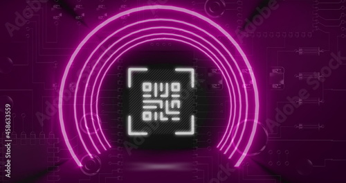 QR code scanner with neon elements against close up of computer server