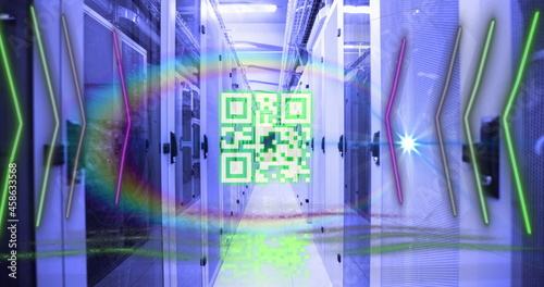 QR code scanner with neon elements against empty server room