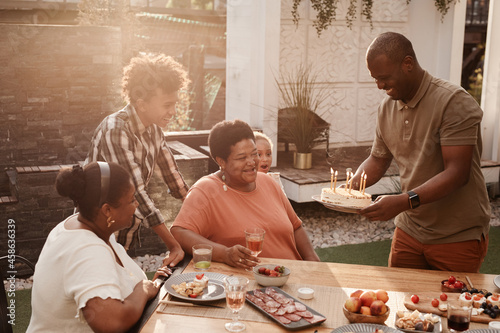 Portrait of happy African-American family celebrating grandmothers Birthday outd Fototapet