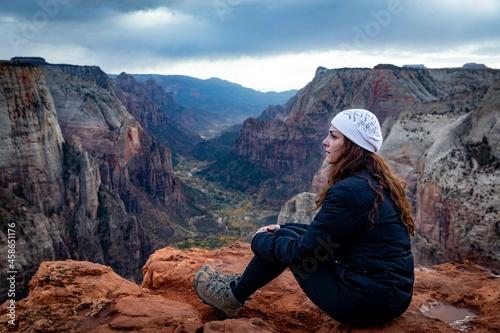 Obraz na plátně A person on the top of a mountain