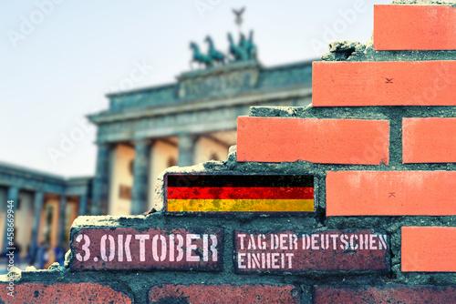 Fotografering Eine Mauer in Berlin und Hinweis auf 3 Oktober Tag der deutschen Einheit