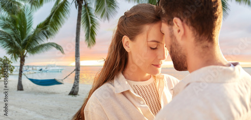 Obraz na plátně leisure, relationships and people concept - happy couple with closed eyes over t