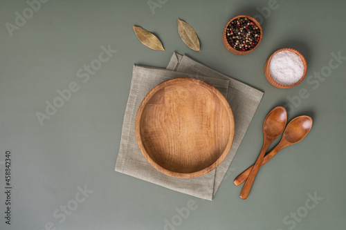 Wood cutting board and napkin on wooden table and spice, pepper, salt Fotobehang