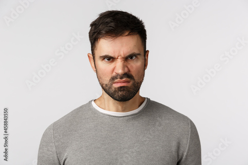 Fototapeta Close-up studio shot hateful and outraged, aggressive scary bearded adult man in