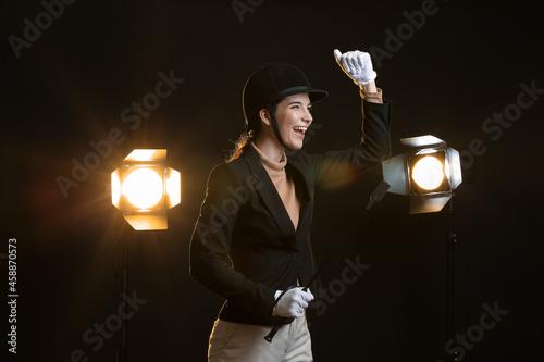 Wallpaper Mural Happy female jockey on dark background