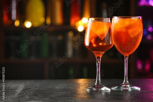 Glasses of tasty aperol spritz cocktail on table Fototapet