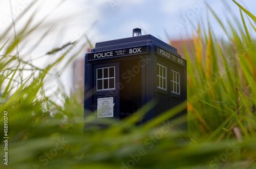 Photo Blue police box as Tardis from Doctor Who in green grass