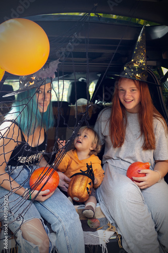 Wallpaper Mural Diverse family friends celebrating Halloween in car trunk outdoors