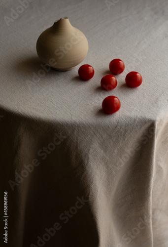 Fototapeta fine art still life with tomatoes and linen texture