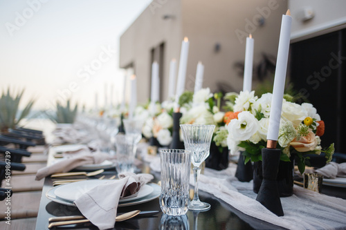 Fotografie, Obraz Detail of a table set for wedding banquet with floral decorations Wedding ceremo