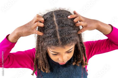 Obraz na plátně Girl itchy his hair on isolated indoors background health care.